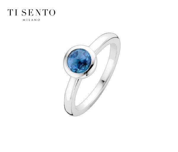 Magnifique bague pour dame en argent rhodié sertie d'un cristal bleu